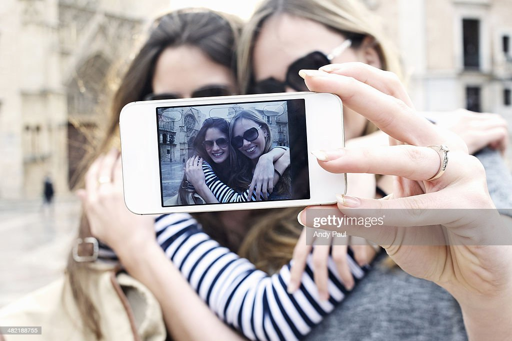 Two young female friends taking a self portrait, Valencia, Spain : Stock Photo