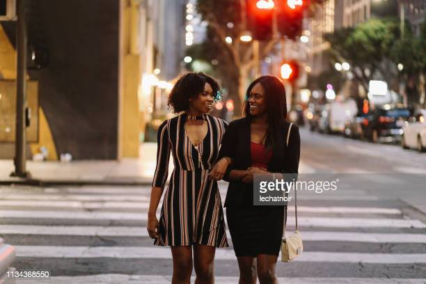 Two young female friends walking in downtown Los Angeles
