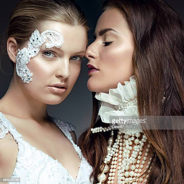 Two young female models wearing pearl jewellery