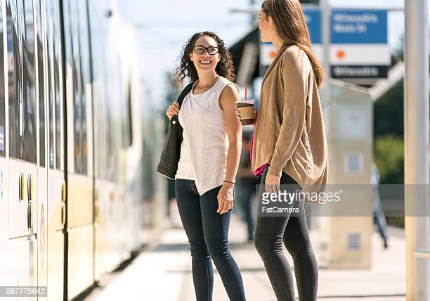 Two young female professionals having a fun conversation