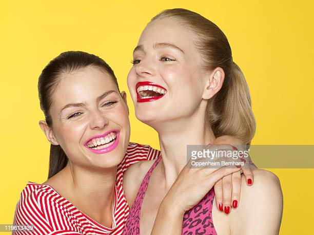 two young females laughing
