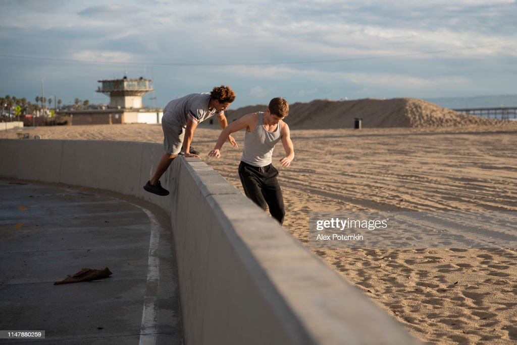 Two young friends jogging at the beach : Stock Photo