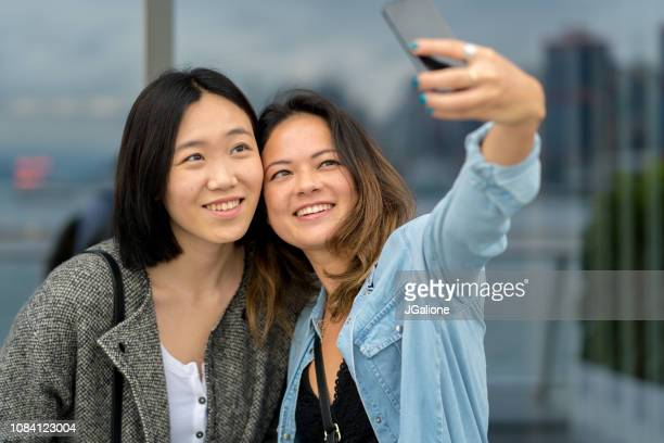 Two young friends taking a selfie together