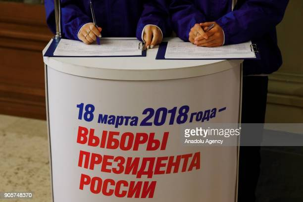 Two young girl volunteers collect signatures in favor of acting president Vladimir Putin who wants to run presidential elections as an independent...