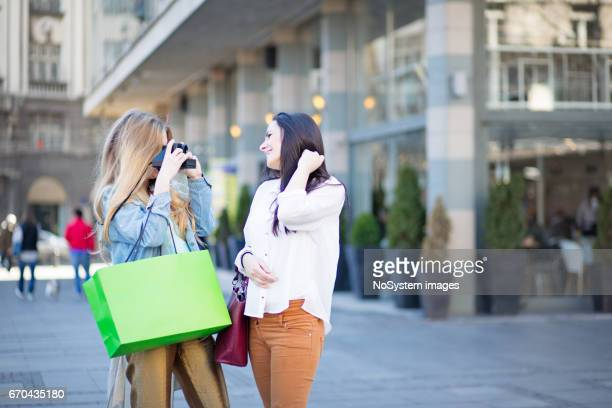 Two young girlfriends, having fun, photographing, shopping. Belgrade, Serbia, Europe