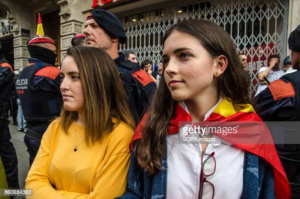 Two young girls are interposed between the Catalan local police and the crowd that is shouting them Hispanic Heritage Day is being celebrated across...