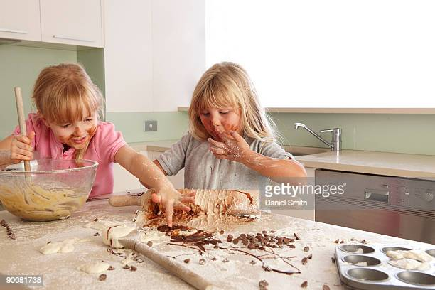 two  young girls cooking - messy stock pictures, royalty-free photos & images