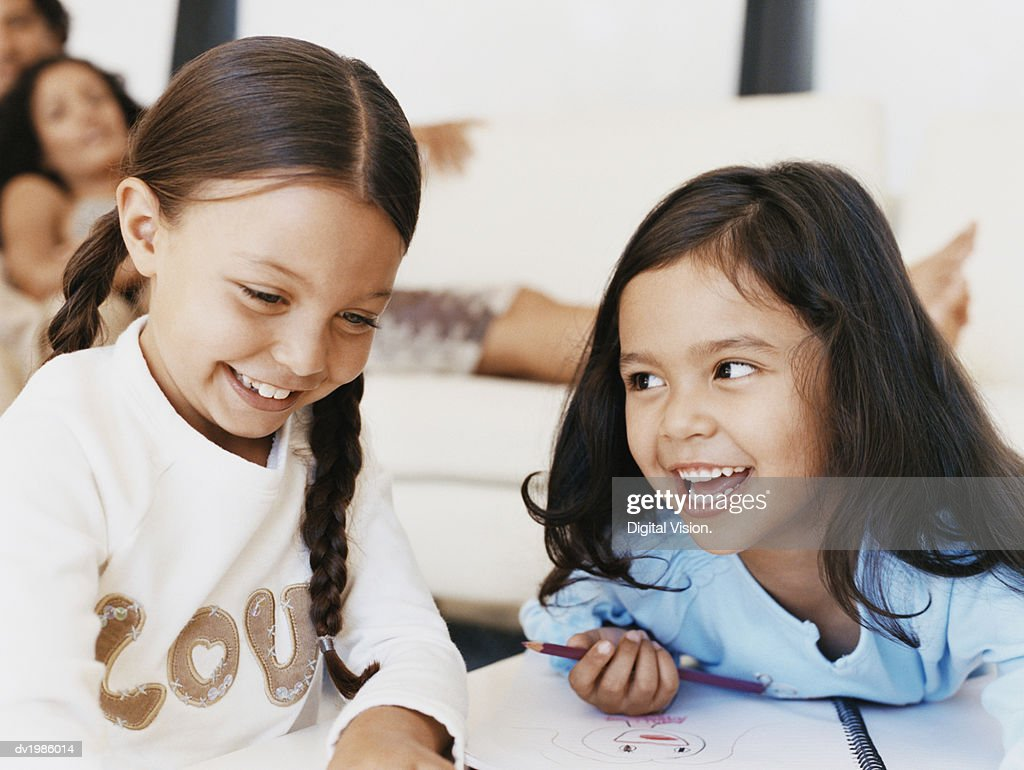 Two Young Girls Drawing : Stock Photo