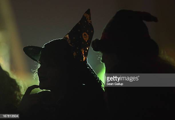 Two young girls dressed as witches attend festivities in Mauerpark park on Walpurgis night on April 30 2013 in Berlin Germany Walpurgis night is...