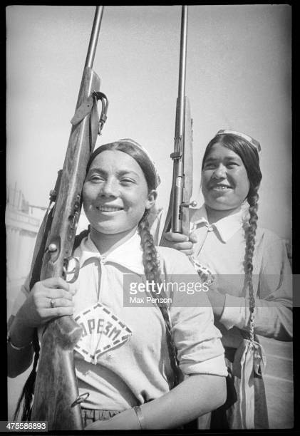 Two young girls from Khorezm team with guns on their shoulders Uzbekistan circa 1940