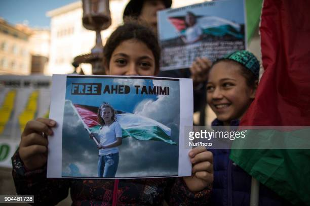 Two young girls hold a placard with a sign to ask the liberation of Ahed Tamimi in front of italian Parliament on January 13 2018 A hundred of...