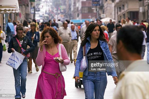 Two young girls in the street Principe in the center of the city Vigo Pontevedra Galicia