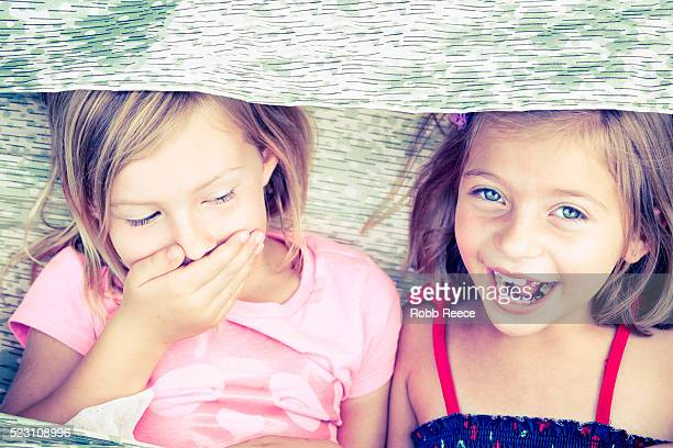 two young girls (6-9) laughing and having fun - robb reece stockfoto's en -beelden