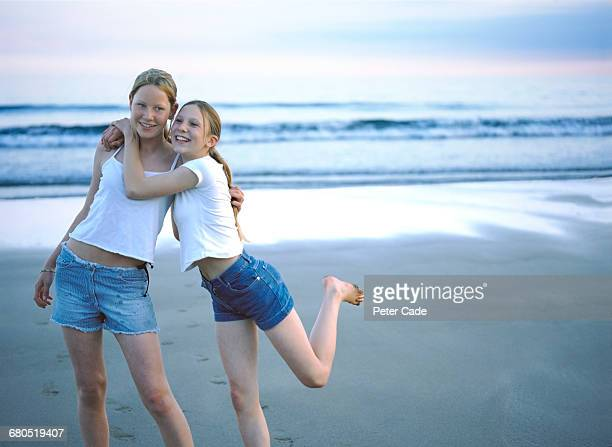 two young girls on beach - only teenage girls stock pictures, royalty-free photos & images