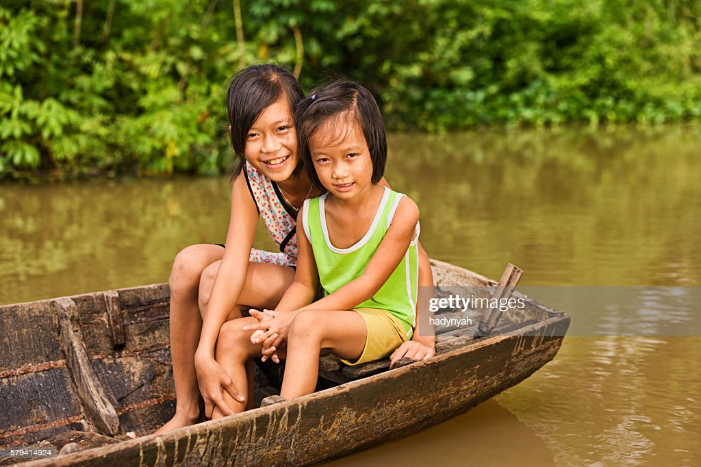 Two Young Girls On Boat In Mekong River Delta Vietnam Stock Photo  Getty Images-2123
