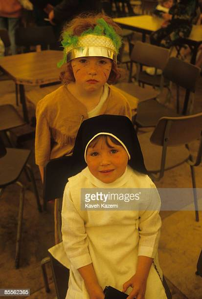 Two young girls one dressed as a nun during a childrens festival in the Catholic residential area of west Belfast 18th September 1985