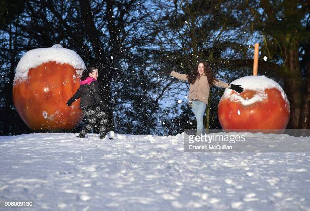 Two young girls play in the snow on January 17 2018 in Belfast Northern Ireland The Met Office has placed an amber weather warning alert on the...