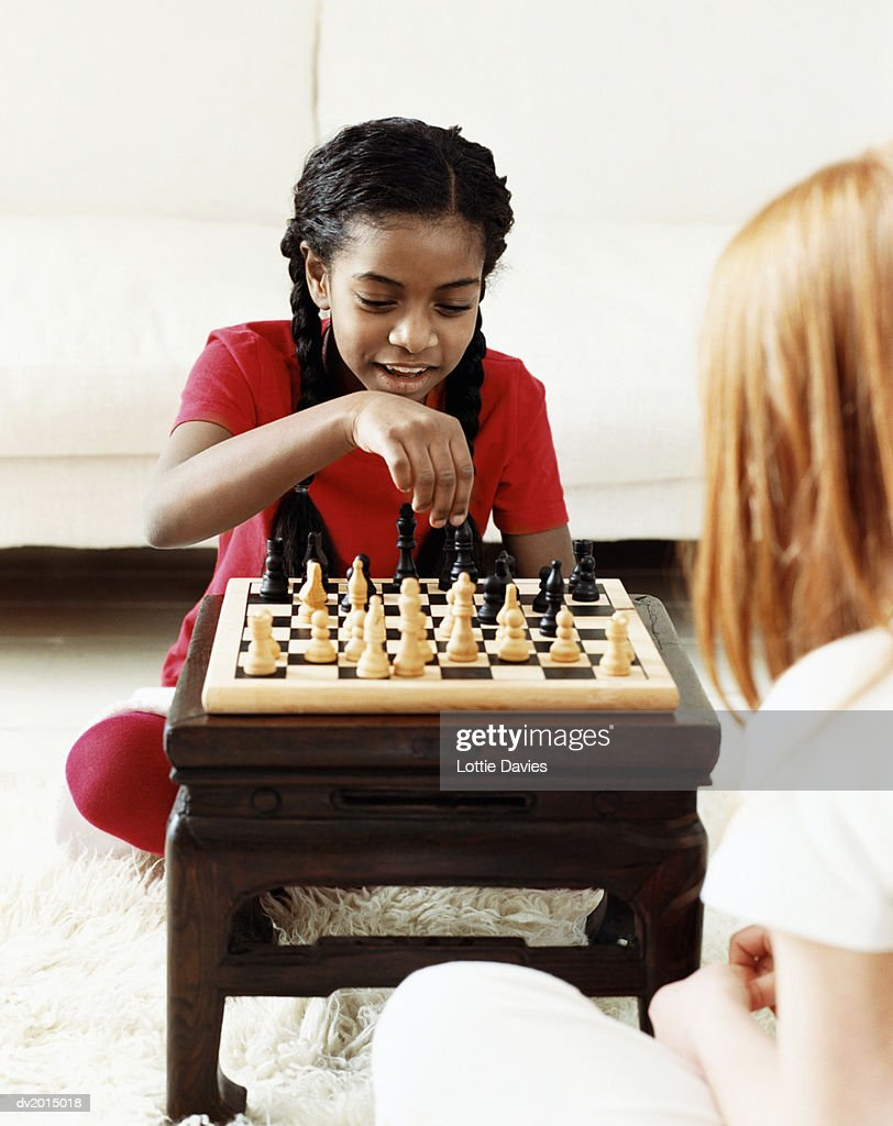 Two Young Girls Playing Chess : Stock Photo