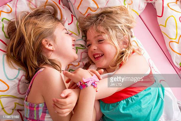 Two Young Girls playing together