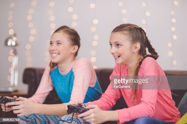 Two young girls playing video games