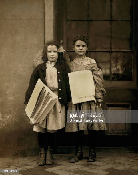 Two Young Girls Selling Newspapers FullLength Portrait Wilmington Delaware USA Lewis Hine for National Child Labor Committee May 1910