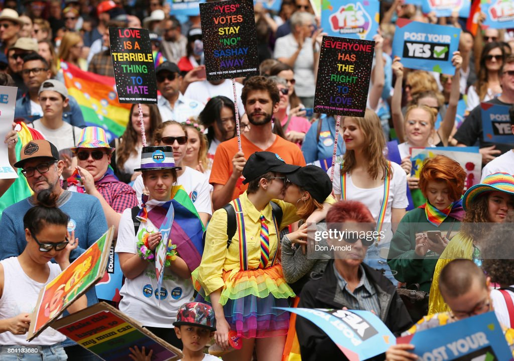Two young girls share a kiss during a speech at the YES March for Marriage Equality on October 21, 2017 in Sydney, Australia. Australians are currently taking part in the Marriage Law Postal Survey, which is asking whether the law should be changed to allow same-sex marriage. Results will be announced on November 15.