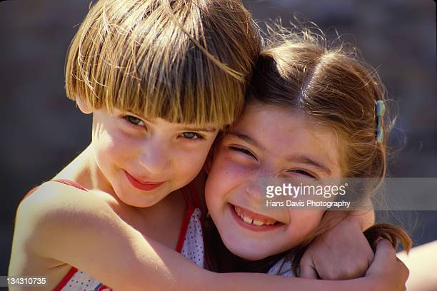 Two young girls smiling at camera