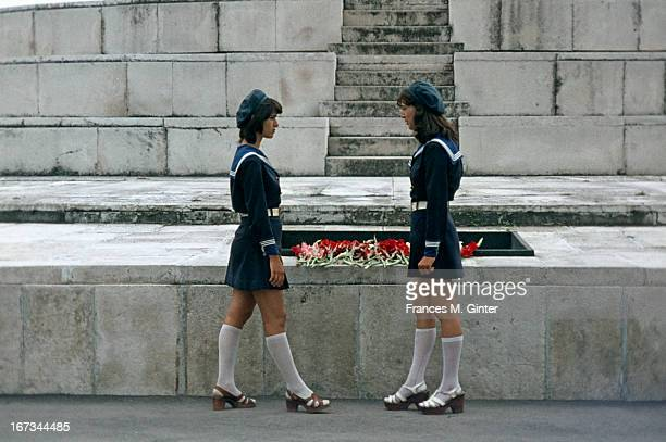 Two young girls stand beside the Monument to Fighters Against Fascism in Varna Bulgaria August 1977