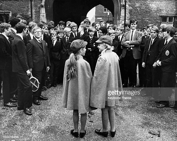 Two young girls Suzannah WARD and Kim LAWRENCE surrounded by boys on the first day of classes at King's School in Ely England on September 9 1970