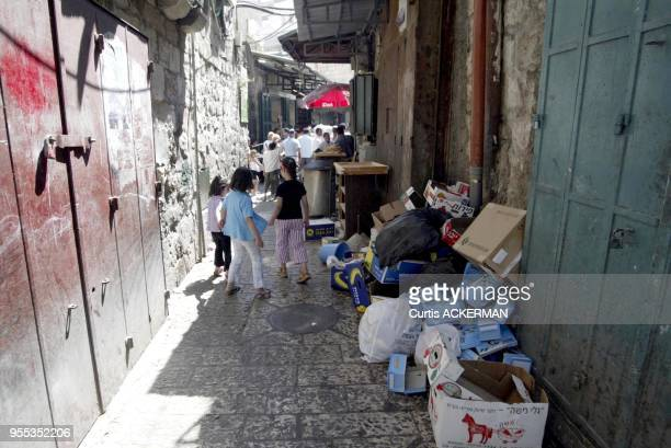 Two young girls walk through a back alley in the Muslim Quarter of Jerusalem's Old City The Muslim Quarter derives most of the business from the...