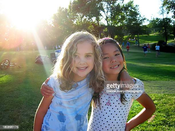 Two young girls with arms around eachother