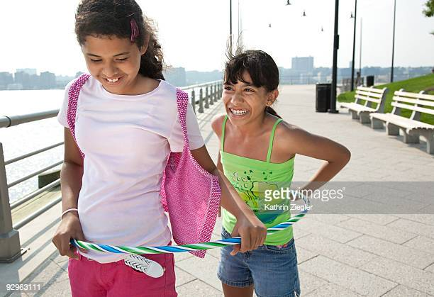 two young girls with hula hoop