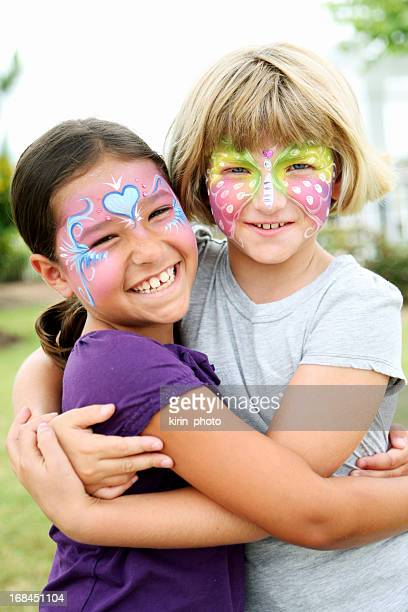 Two young girls with their faces painted