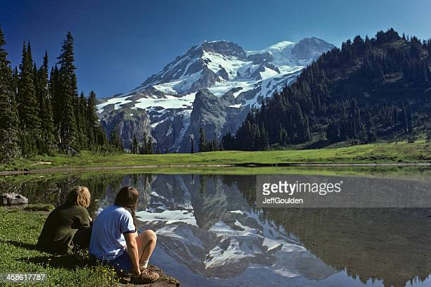 Young Hikers Enjoying the View of Mount Rainier