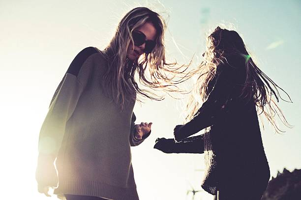 Two Young Indie Girls Dancing In The Sun Wall Art