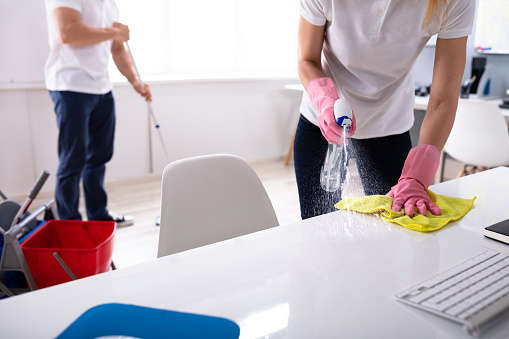Two Young Janitor Cleaning The Office 1157269326