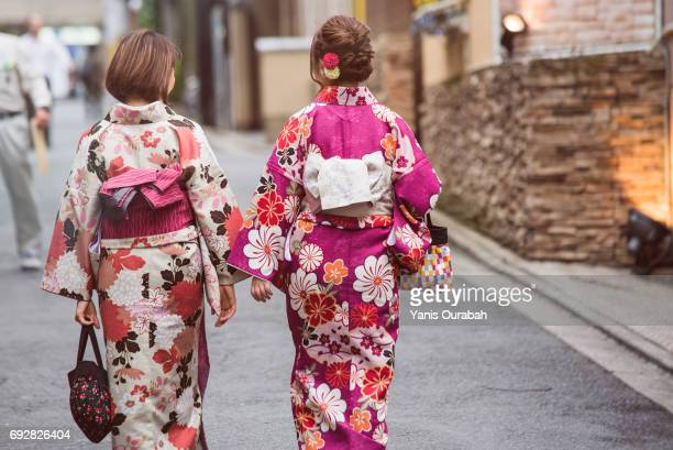 Two young Japanese girls wearing yukata in old streets of Gion, Kyoto