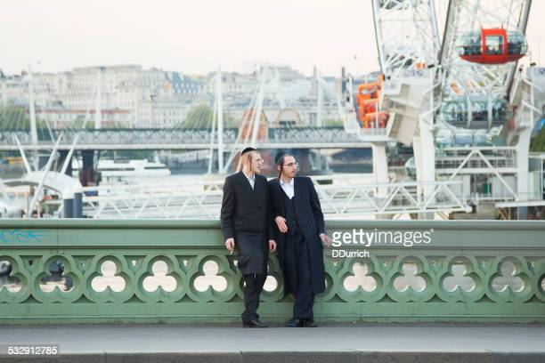 two young jewish man at westminster bridge - jewish man stock photos and pictures