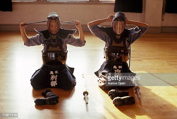 Two young Kendo players prepare for a class.