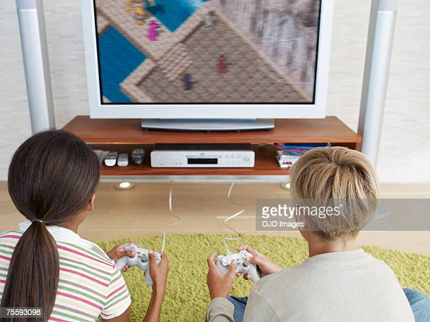 Two young kids playing video games