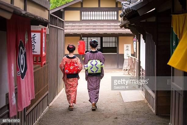 two young kimono women walking together in old edo village - edo period ストックフォトと画像