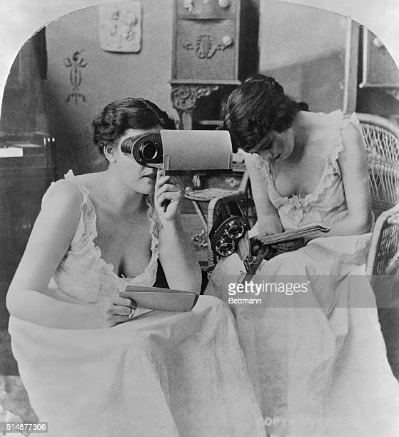 Two young ladies studying stereopticon pictures Photograph ca 1900 BPA2#3678