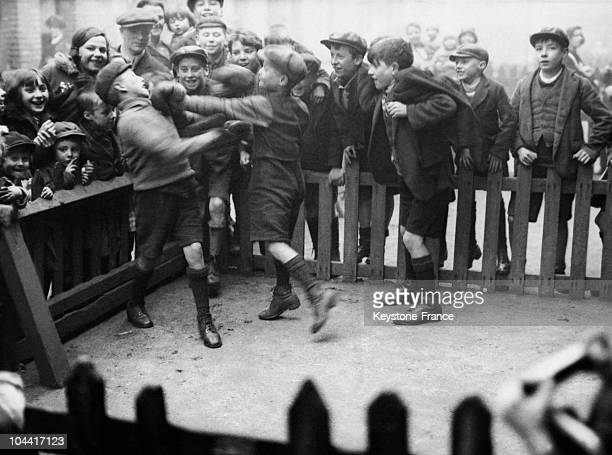 Two young London urchins participating in an improvised boxing fight in the streets of Camberweel district on February 27 upon the occasion of the...