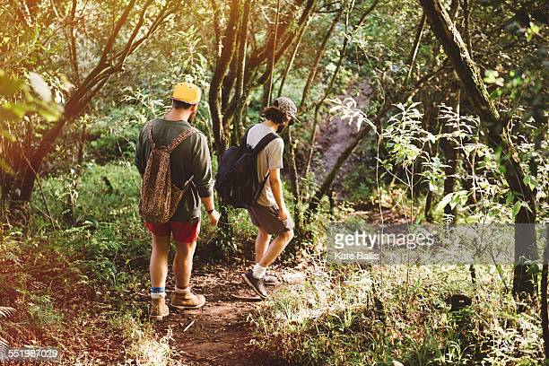Two young male friends hiking in rain forest at Lake Atitlan, Guatemala