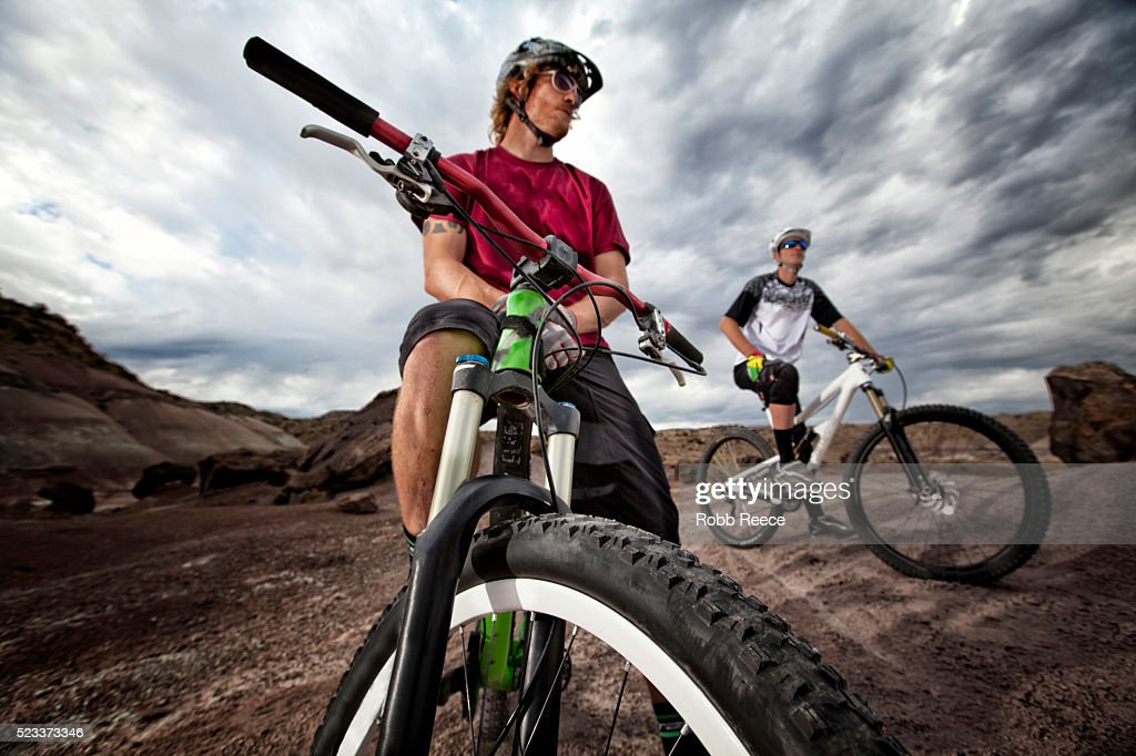 Two young male mountain bikers ready to ride the trails : Stock Photo