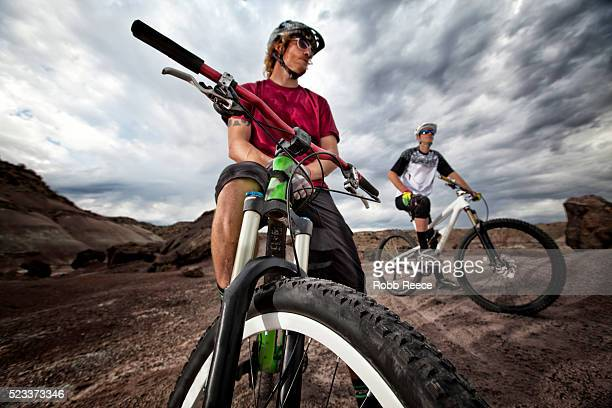 two young male mountain bikers ready to ride the trails - robb reece bildbanksfoton och bilder