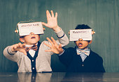 Two Young Male Nerds with Virtual Reality Headsets