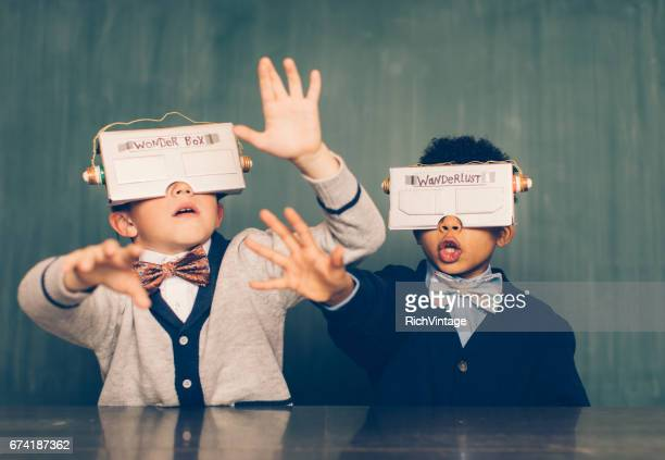 two young male nerds with virtual reality headsets - escapism stock pictures, royalty-free photos & images