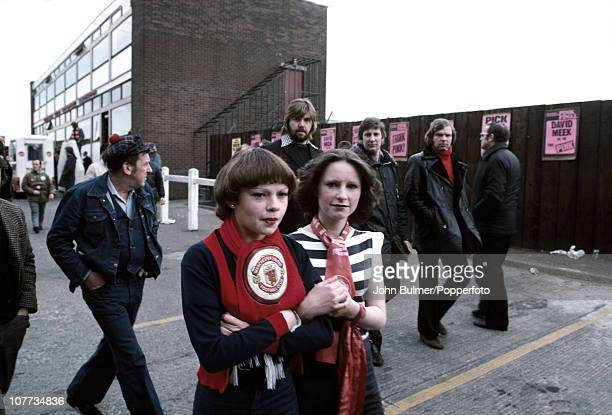Two young Manchester United fans on their way to a match in Manchester, England in 1976.