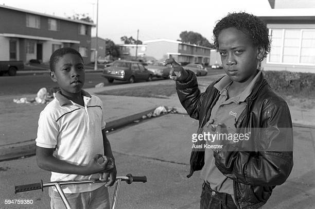 Two young members of Grape Street pose with their trademark 'g' hand sign The Grape Street Watts Crips are a mostly African American street gang...